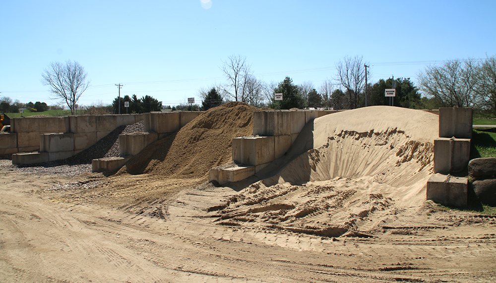 Piles of sand, stone, & soil at Keleny
